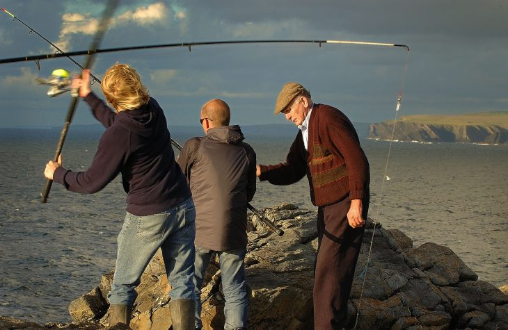 Men fishing for Mackerel off Cliffs in Ireland